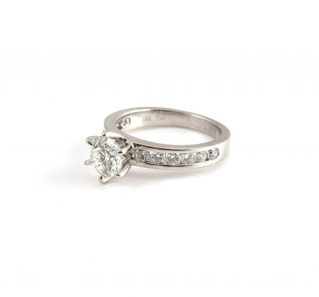 Six claw solitaire with channel set diamond band   B22426