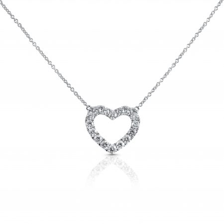 An 18K white gold claw set diamond heart necklace featuring sixteen diamonds in a heart shape pendant, suspended from a trace link chain | B22436