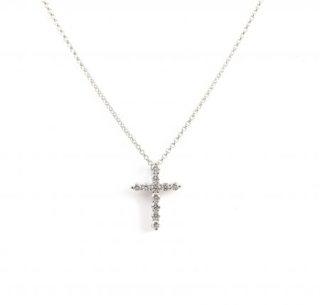 An 18K white gold claw set diamond cross pendant.