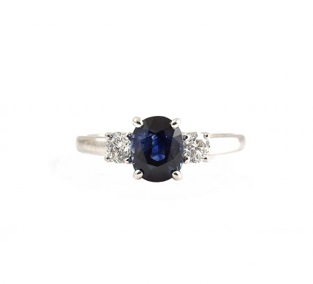 An 18K white gold Sapphire and diamond trilogy ring.