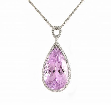 An 18K white gold Kunzite and diamond pendant.