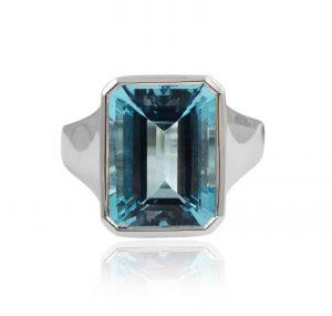 Blue topaz ring emerald cut 9.65ct in a bezel setting 9K white gold