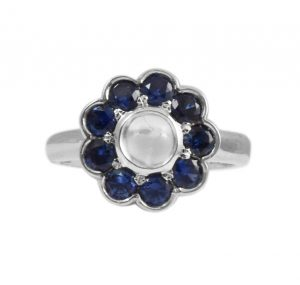 moonstone ring surrounded by 9 blue sapphiresin 18k white gold
