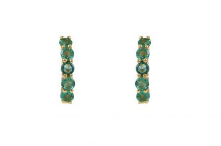 emerald green mini hoop huggies set in 18K yellow gold in a claw setting