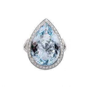 Aquamarine Pear cut diamond ring set in 18K white gold. Featuring an amazing 12.29ct pear cut Aquamarine surrounded by a claw setting of round brilliant cut diamonds totaling up to 1.12ct. Gemstone Carat Aquamarine: 12.29ct Diamond: 170 = 1.12ct