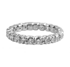 An Eternity Ring with diamonds all the way around set in 18k white gold claw set in a unique scalloped design. The band is set with 22 round brilliant cut diamonds. This design can be made with any size diamonds as a custom make to suit.