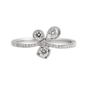 This unique Trio of diamonds ring in 18K white gold, with diamonds half way around the band. Diamond carat: 32 = 0.39ct
