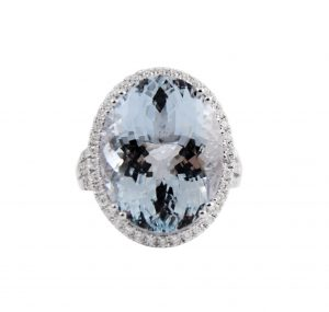 This magnificent Aquamarine Oval cut diamond ring set in 18K white gold. Featuring an amazing 14.73ct oval cut Aquamarine surrounded by a claw setting of round brilliant cut diamonds totaling up to 0.81ct. Gemstone Carat Aquamarine: 14.73ct Diamond: 78 = 0.81ct RING SIZE: M1/2 can be sized up 2 sizes up or down.