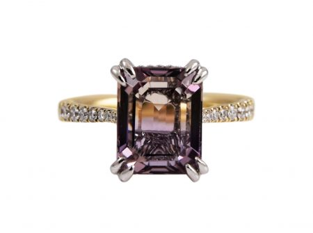 Ametrine and diamond two tone dress ring. Set with a 3.88ct step cut Ametrine claw set with diamonds half way around the band set in 18K yellow and white gold. Gemstone Carat: Ametrine = 3.88ct Diamond Carat: 26 = 0.21ct RING SIZE: L1/2